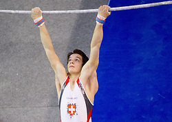 Christian Baumann of Switzerland competes in the Horizontal bar during Final day 2 of Artistic Gymnastics World Cup Ljubljana, on April 27, 2013, in Hala Tivoli, Ljubljana, Slovenia. (Photo By Vid Ponikvar / Sportida.com)