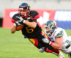 08.07.2011, Tivoli Stadion, Innsbruck, AUT, American Football WM 2011, Group A, Germany (GER) vs Mexico (MEX), im Bild Pascal Maier (Germany, #6, WR) gets stopped by Montembruck Alberto (Mexico, #15, LB)  // during the American Football World Championship 2011 Group A game, Germany vs Mexico, at Tivoli Stadion, Innsbruck, 2011-07-08, EXPA Pictures © 2011, PhotoCredit: EXPA/ T. Haumer