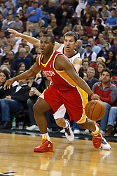 March 7, 2011; Sacramento, CA, USA;  Houston Rockets point guard Kyle Lowry (7) dribbles past Sacramento Kings point guard Beno Udrih (19) during the first quarter at the Power Balance Pavilion.