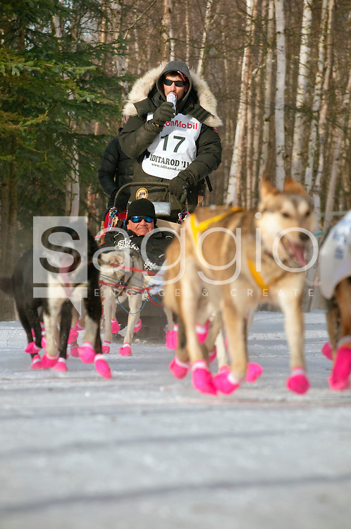 Musher stroll along the Chester Creek Trail during the 2011 Ceremonial Start.