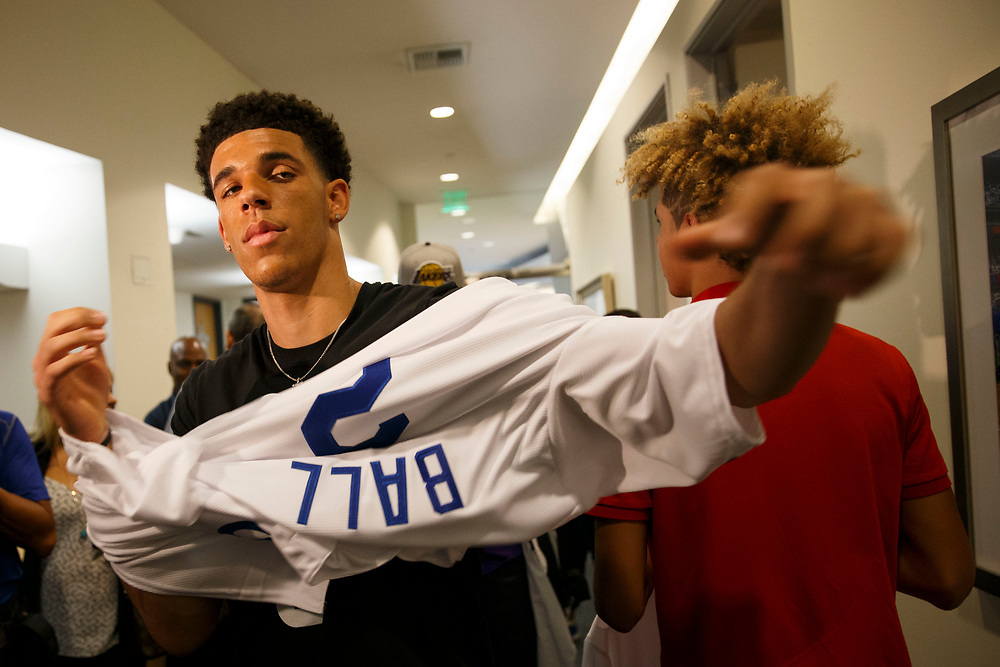 Lakers draft pick Lonzo Ball puts on a Dodgers jersey before throwing out the first pitch at Dodger Stadium on Friday, June 23, 2017 in El Segundo, California. The Lakers selected Lonzo Ball as the No. 2 overall NBA draft pick and is the son of LaVar Ball. © 2017 Patrick T. Fallon