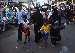 """August 22, 2017 - Kolkata, India - Indian Muslim women walks through the market  after the historical judgement of Supreme Court on Triple Talaq has been declared unconstitutional on Tuesday, 22nd August, 2017 in Kolkata , India. In a landmark 3-2 verdict, the Supreme Court  """"set aside"""" the centuries-old practice of instant triple talaq or  """"talaq-e-biddat"""" in which Muslim men divorce their wives by uttering  Talaq three times in quick succession. The Supreme Court by a majority verdict ruled that the practice of divorce through triple talaq among Muslims is ''void'', ''illegal'' and ''unconstitutional''. The apex court by 3:2 verdict held that the triple talaq is against the basic tenets of Quran. Over a million Muslims from across India, the majority of them women, have signed a petition to end the controversial divorce practice of triple talaq. (Credit Image: © Sonali Pal Chaudhury/NurPhoto via ZUMA Press)"""