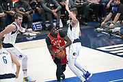 Toronto Raptors forward OG Anunoby (3) attempts to get around Dallas Mavericks forward Maxi Kleber (42) while Luka Doncic (77) comes for support during an NBA basketball game, Saturday, Nov. 16, 2019, in Dallas. The Mavericks defeated the Raptors 110-102. (Wayne Gooden/Image of Sport)