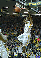 December 28, 2011: Iowa Hawkeyes guard/forward Roy Devyn Marble (4) dunks the ball during the NCAA basketball game between the Purdue Boilermakers and the Iowa Hawkeyes at Carver-Hawkeye Arena in Iowa City, Iowa on Wednesday, December 28, 2011. Purdue defeated Iowa 79-76.