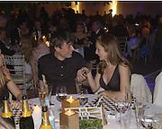 Alex James and Lucy Yeomans. Louis Vuitton Concours d'Elegance, Hurlingham.  8 June 2002.  Copyright Photograph by Dafydd Jones 66 Stockwell Park Rd. London SW9 0DA Tel 020 7733 0108 www.dafjones.com
