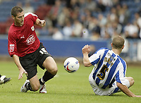 Photo: Aidan Ellis.<br /> Huddersfield Town v Bristol City. Coca Cola League 1. 12/08/2006.<br /> Bristol's Phil jevons and Huddersfield's David Mirfin tackle for the ball