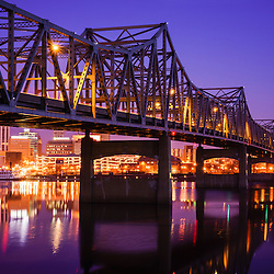 Peoria Illinois Murray Baker Bridge at night. The Murray Baker Bridge spans the Illinois River connecting Peoria with East Peoria as Interstate I-74. Built in 1958, the bridge is named after Murray Baker who started a company that would later become Caterpillar.