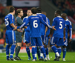 MOSCOW, RUSSIA - Wednesday, May 21, 2008: Chelsea's captain John Terry and Frank Lampard  with their team-mates surround the referee during the UEFA Champions League Final at the Luzhniki Stadium. (Photo by David Rawcliffe/Propaganda)
