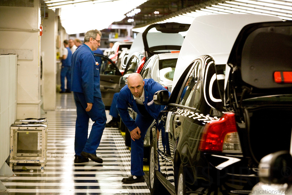GHENT - BELGIUM - 13 NOVEMBER 2008 -- Volvo Cars Gent -- Workers at the quality control section at the final part of the Volvo assembly line.  Photo: Erik Luntang
