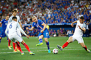 Iceland midfielder Gylfi Þór Sigurðsson (10) has a shot on goal and scores a goal during the Round of 16 Euro 2016 match between England and Iceland at Stade de Nice, Nice, France on 27 June 2016. Photo by Andy Walter.