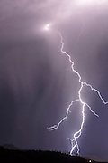 Cloud-to-ground lightning, single bolt at night with side forks to air, © 2015 David A. Ponton