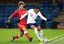 Denmark U21's Joachim Andersen (left) and England U21's Dominic Calvert-Lewin battle for the ball during the international friendly match at the Blue Water Arena, Esbjerg.