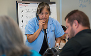 Volunteers from CenterPoint Energy work a phone bank to reach students at risk of dropping out, September 3, 2014.