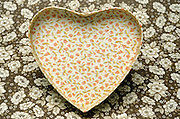a box top in heart form against a floral background