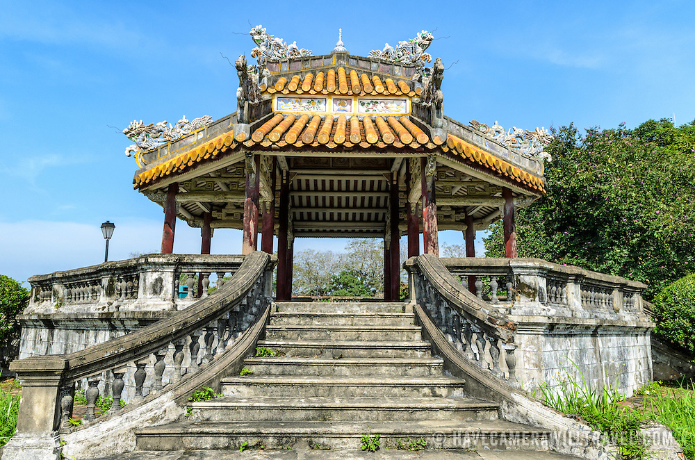 A pagoda in the grounds at the Imperial City in Hue, Vietnam. A self-enclosed and fortified palace, the complex includes the Purple Forbidden City, which was the inner sanctum of the imperial household, as well as temples, courtyards, gardens, and other buildings. Much of the Imperial City was damaged or destroyed during the Vietnam War. It is now designated as a UNESCO World Heritage site.