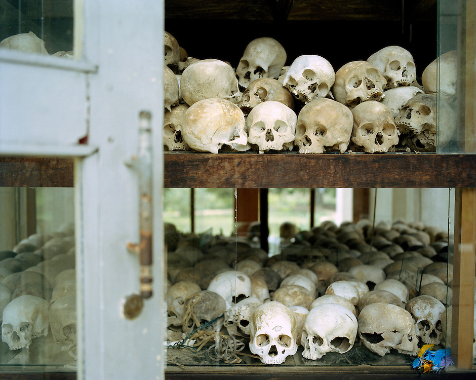 Phnom Penh, skulls on Chuong Ek Memorial Site. Decades after war, civil war and the terror regime of Pol Pot's Khmer Rouge an oppressed nation wants to get back to normal.<br /> <br /> This Year, an United Nations backed tribunal takes legal proceedings against the last Khmer Rouge leaders that are accused of crimes against humanity. As of yet Cambodian government did not contribute much to shed light on the genocide, leaving one oft the most horrible crimes in human history - the assassination of a quarter of the country's population - unatoned.<br /> <br /> Thirty years after the Pol Pot regime the past still overshadows one's life in postwar Cambodia.
