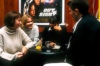 University of Westminster students socialising drinking coffee and chatting.