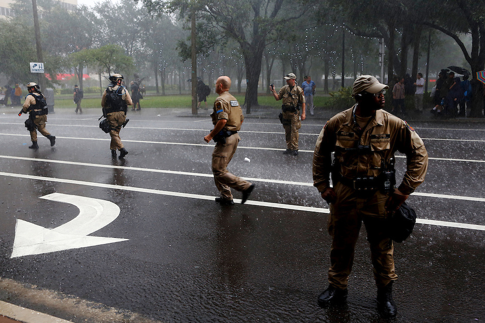 Law enforcement officers guard the streets in the pouring rain from Tropical Storm Isaac during the 2012 Republican National Convention on August 27, 2012 in Tampa, Fla.