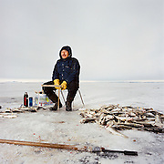 KIVALINA, ALASKA - 2007: Sylvester Swan Jr. Tom Cod Fishing.