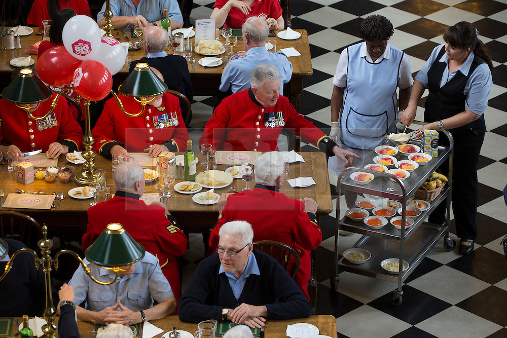 © licensed to London News Pictures. London, UK 02/10/2012. Chelsea Pensioners served puddings as they launch The Soldiers' Charity Big Curry season with a special curry lunch at Royal Hospital Chelsea's Royal Hall in London on 02/10/12. Photo credit: Tolga Akmen/LNP