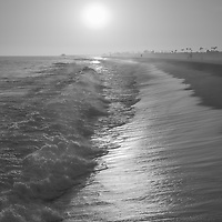 Newport Beach California sunset black and white photo. Newport Beach is a coastal beach city along the Pacific Ocean in Orange County Southern California in the Western United States of America. Photo is Copyright ⓒ 2017 Paul Velgos with All Rights Reserved.