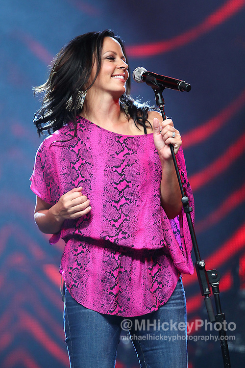 Sara Evans performs at the Best Buy Country Music Expo at the Indiana State Fairgrounds in Indianapolis, Indiana. Indianapolis, Indiana concert photography by Michael Hickey.