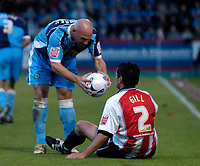 Photo: Richard Lane.<br />Cheltenham Town v Wycombe Wanderers. Coca Cola League 2. Play off Semi Final, 2nd Leg. 18/05/2006. <br />Wycombe's Tommy Mooney gives the ball back to Jerry Gill.