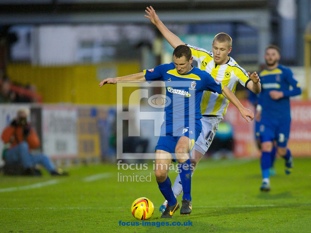 Picture by Alan Stanford/Focus Images Ltd +44 7915 056117<br /> 11/01/2014<br /> Andrew Frampton of AFC Wimbledon takes on Jayden Stockley of Torquay United during the Sky Bet League 2 match at the Cherry Red Records Stadium, Kingston.