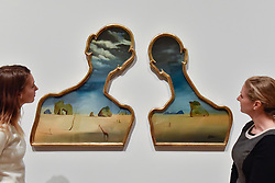 """© Licensed to London News Pictures. 03/10/2017. London, UK.   Staff members view """"Couple With Their Heads Full of Clouds"""", 1937, by Salvador Dali at the preview of """"Dali / Duchamp"""", a new exhibition of works by Salvador Dali and Michel Duchamp taking place at the Royal Academy of Arts in Piccadilly.  Over 80 artworks in different media are on display from 7 October to 3 January 2018.   Photo credit : Stephen Chung/LNP"""