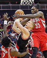 Feb 6, 2016; Houston, TX, USA;  Portland Trail Blazers center Mason Plumlee (24) is defended by Houston Rockets guard Patrick Beverley (2) and forward Montrezl Harrell (35) in the second half at Toyota Center. Portland won 96 to 79. Mandatory Credit: Thomas B. Shea-USA TODAY Sports