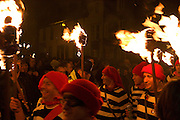 Late night parade: Members of a Lewes bonfire society marching with torches. Lewes, 5/11/5..
