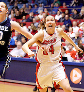 Rhode Island sophomore Emilie Cloutier (20) and UD senior Justine Raterman (34) as the Rhode Island Rams play the University of Dayton Flyers at UD Arena in Dayton, Saturday, January 7, 2012.