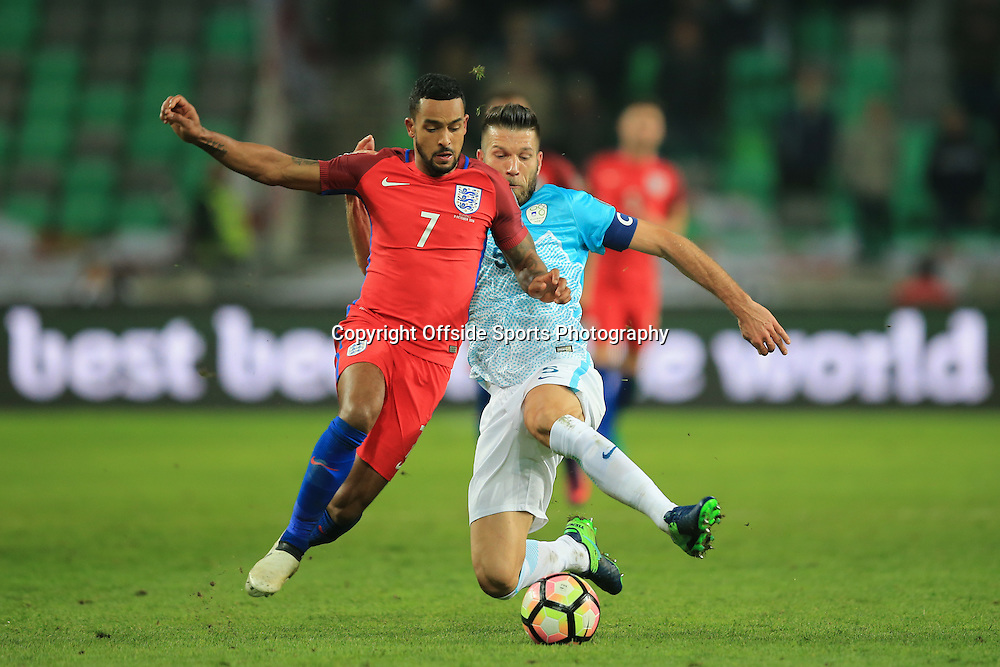 11 October 2016 - FIFA 2018 World Cup Qualifying (Group F) - Slovenia v England - Theo Walcott of England in action with Bostjan Cesar of Slovenia - Photo: Marc Atkins / Offside.