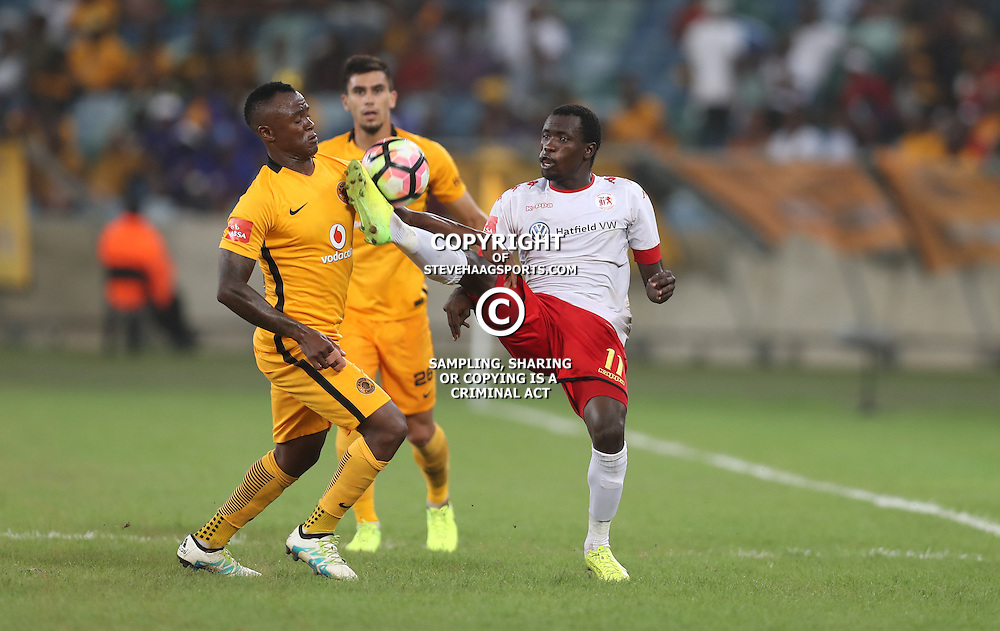 DURBAN, SOUTH AFRICA - FEBRUARY 18: Tsepo Masilela of Kaizer Chiefs and Charlton Mashumba of Highlands Park go for the ball during the Absa Premiership match between Kaizer Chiefs and Highlands Park at Moses Mabhida Stadium on February 18, 2017 in Durban, South Africa. (Photo by Steve Haag/Gallo Images)