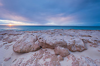 Dawn rises over the sandstone platforms high above the beachfront, De Hoop Marine Protected Area, Western Cape, South Africa