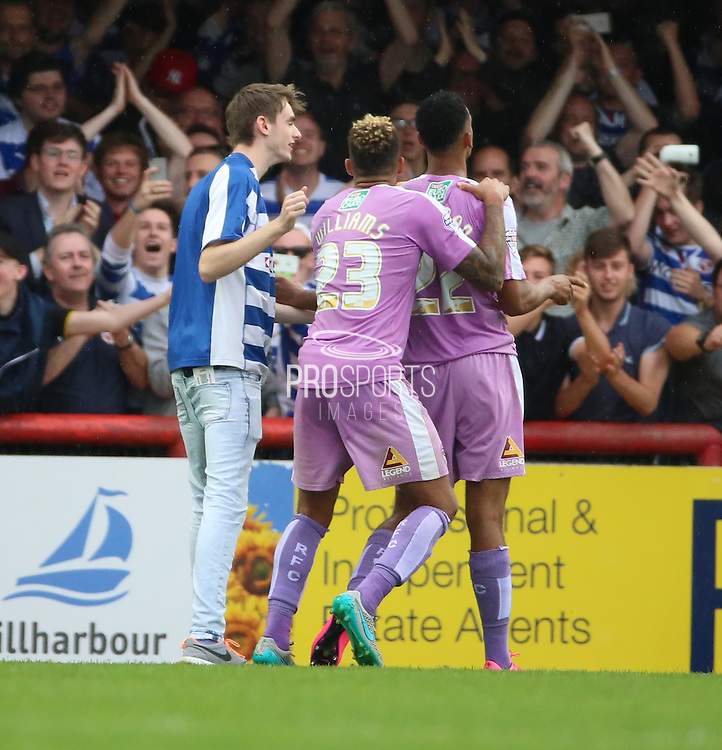 Nick Blackman (Reading striker) celebrating scoring penalty with Danny (Daniel) Williams (Reading midfielder) and a pitch invader during the Sky Bet Championship match between Brentford and Reading at Griffin Park, London, England on 29 August 2015. Photo by Matthew Redman.