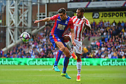 Crystal Palace defender Martin Kelly (34) keeps the ball from Stoke defender Glen Johnson (8) during the Premier League match between Crystal Palace and Stoke City at Selhurst Park, London, England on 18 September 2016. Photo by Jon Bromley.