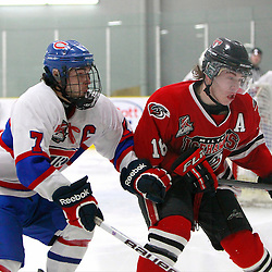 TORONTO, ON - Feb 16 : Ontario Junior Hockey League Game Action between the Milton Ice Hawks and the Toronto Jr. Canadiens, Mark Spadafora #7 of the Toronto Jr. Canadiens Hockey Club and Shane Bennett #18 of the Milton Ice Hawks Hockey Club chase after the puck during second period game action.<br /> (Photo by Brian Watts / OJHL Images)