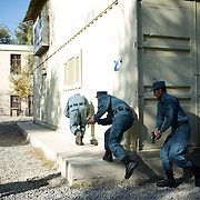 November 14, 2012 - Kabul, Afghanistan: Afghan National Police (ANP) cadets simulate a raid to a Taliban house during combat exercises at the Afghan Nacional Police Academy...ANP Academy trains 1250 cadets at the time during a period of four years. Every year, five hundred new recruits are selected, out of more than nine thousand of candidates, to join the academy and other five hundred graduate. Fifteen per cent of the recruits are women. (Paulo Nunes dos Santos/Polaris)