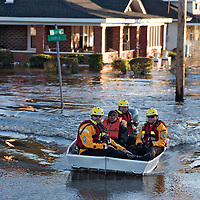 A swift water rescue team transports a resident to safety on a street covered with floodwaters caused by rain from Hurricane Matthew in Lumberton, N.C., Monday, Oct. 10, 2016. (AP Photo/Mike Spencer)
