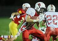 Western Dubuque's Dylan James (24) tries to pull away from Marion's Tyler Gunderson (5) during their first round playoff game at Thomas Park Field in Marion on Wednesday, October 24, 2012.