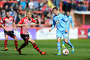 Exeter City's Jayden Stockley and Morecambe's Andrew Fleming during the Sky Bet League 2 match between Exeter City and Morecambe at St James' Park, Exeter, England on 30 April 2016. Photo by Graham Hunt.