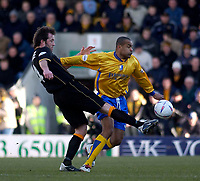 Photo. Glyn Thomas.<br /> Mansfield Town v Hull City.<br /> Nationwide League Division 3.<br /> Field Mill, Mansfield. 06/03/2004.<br /> Hull's Ian Ashby (L) battles for the ball with Laurent D'Jaffo.