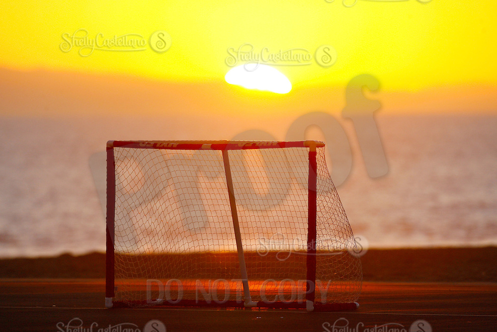 22 January 2011:  PBHA outdoor roller hockey sunset net on the blacktop at the beach.