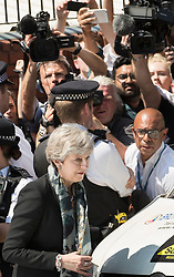 © Licensed to London News Pictures. 19/06/2017. London, UK. Prime Minister Theresa May is surrounded by reporters and TV crews as she leaves Finsbury Park Mosque in north London where earlier a van ploughed into a crowd near Finsbury Park Mosque, as they finished taraweeh, Ramadan evening prayers. One person has been killed and 10 people are injured. Photo credit: Peter Macdiarmid/LNP