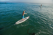 Dax McPhillips paddleboarding at Dana Point, California.