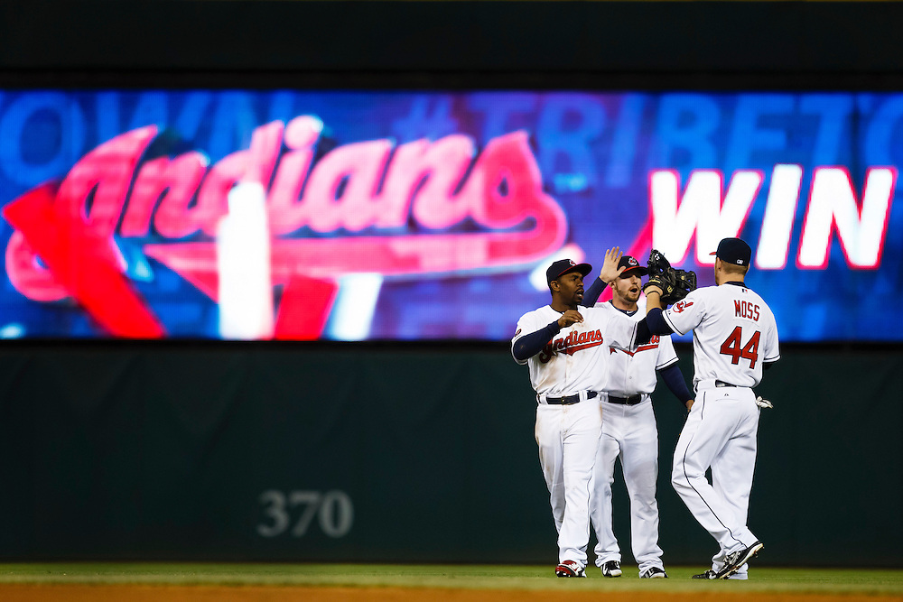 May 1, 2015; Cleveland, OH, USA; Cleveland Indians right fielder Brandon Moss (44) left fielder Tyler Holt (62) and center fielder Michael Bourn (24) celebrate after the game against the Toronto Blue Jays at Progressive Field. Cleveland won 9-4. Mandatory Credit: Rick Osentoski-USA TODAY Sports
