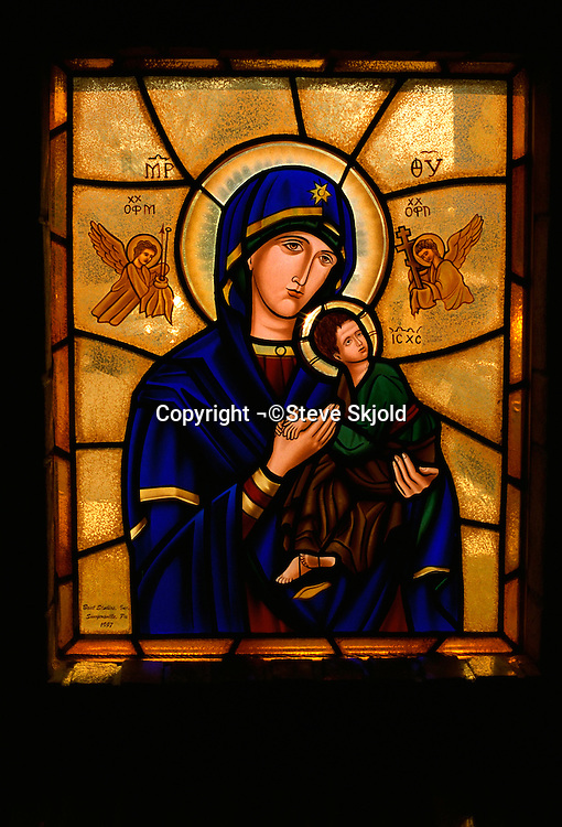 Stain glass window showing the Virgin Mary and Christ. St Lukes Catholic Church St Louis Park Minnesota USA