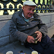 An intoxicated homeless man receives assistance from Dublin Simon Community's Soup Run team in Dublin city center.