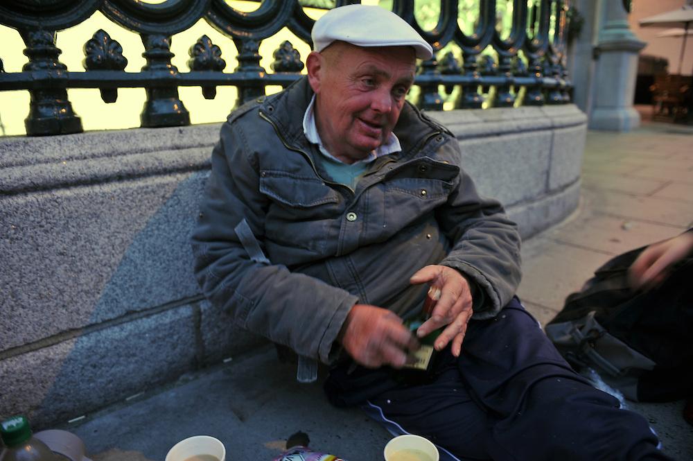 An intoxicated homeless man receives assistance from Dublin Simon Community's Soup Run team in Dublin city center.